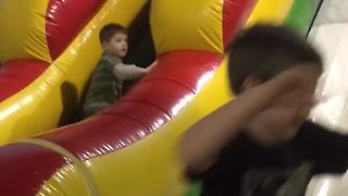 Tot Boy Trips On A Ball And Falls