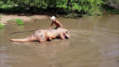 Man in T-Rex costume helps catch massive catfish