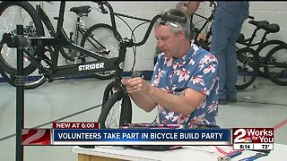 Volunteers take part in bicycle build party