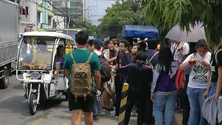 People Line Streets After Earthquake Hits Manila - Video