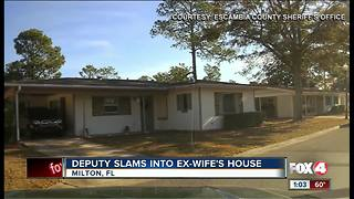 Deputy slams into ex-wife's home - Video