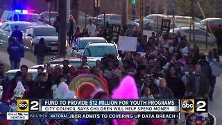 Youth march rallies support for new city fund - Video