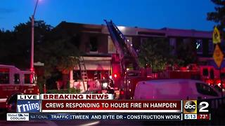 Firefighters injured battling row house fire in Hampden Wednesday morning