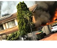 Large Blaze Destroys Homes in Lurnea - Video