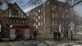 Cleveland firefighters evacuated from burning building for fear of roof collapse
