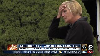 Neighbors save woman from house fire - Video