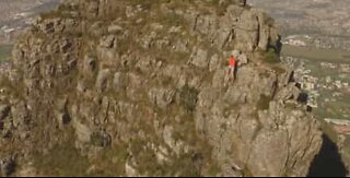 Drone footage of athlete running across Table Mountain ridge