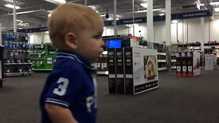 Emotional Toddler Finds Love While Browsing For TVs