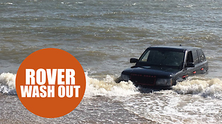 Shocking footage shows Range Rover washed out to sea