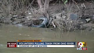 Volunteers from Living Lands and Waters clean up along the Ohio River