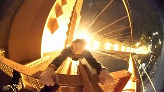 Stomach-churning moment two teenage daredevils dice with death as they dangle from Golden Gate Bridge - Video