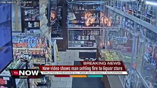 New video shows man setting fire to liquor store - Video