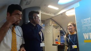 Cabin crew member sings  onboard Ryanair flight - Video