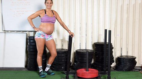 Squat till you pop! Incredible superfit mum keeps up intense eight hours a week weightlifting fitness regime while seven months pregnant