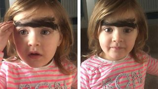 Baby wants to be just like mummy with interesting monobrow make-up look