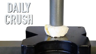 Crushing a hard boiled egg with a hydraulic press - Video