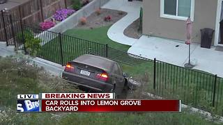 Car rolls down hill, into fence of Lemon Grove home - Video