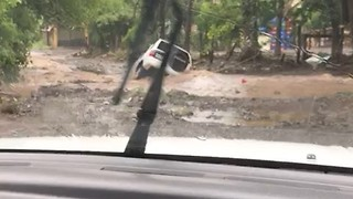 Car Submerged as Tropical Storm Nate Brings Widespread Flooding to Costa Rica - Video
