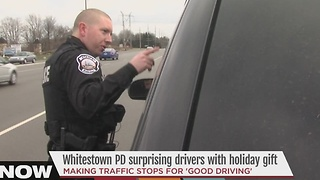Whitestown police officers hand out cash - not tickets - to drivers