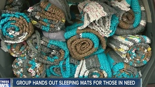 Group hands out sleeping mats for those in need - Video