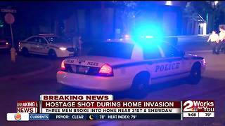 Father and son held hostage in Midtown home invasion - Video