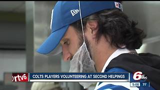 Colts players volunteer at Second helpings - Video