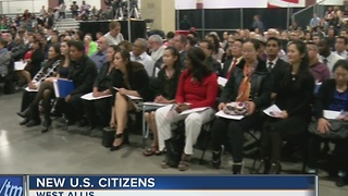 New citizens welcomed at naturalization ceremony - Video