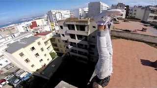Fearless Thrill Seeker Balances On Roof Top - Video