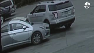 Robber's bullet narrowly misses child's head - Video