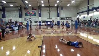 High-school volleyball player takes flight to make unbelievable save - Video
