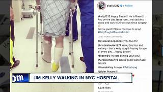 Jim Kelly takes first steps since surgery