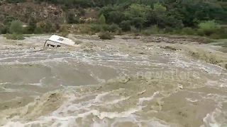 Caravan washed down river amid heavy floods in south of France - Video