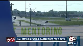 Man stays on top of parking garage for three days - Video