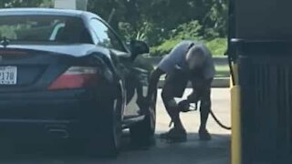 Man cleans car with gasoline