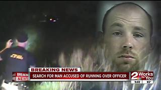 Manhunt underway for man accused of running over police officer - Video