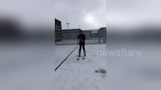 Man skis through snow-filled street after massive storm in Dublin - Video