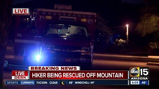 Hiker being rescued off mountain - Video