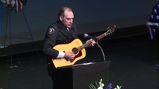 RAW: Fr. Tim Plavac performs original song at Officer Mazany's funeral - Video