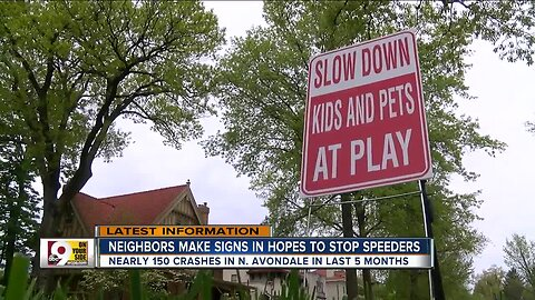 Neighbors make signs to slow speeders