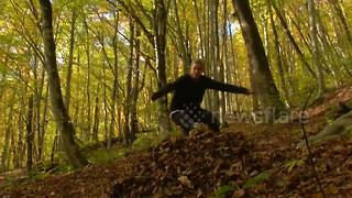 Skiing and snowboarding in a forest with no snow looks amazing - Video