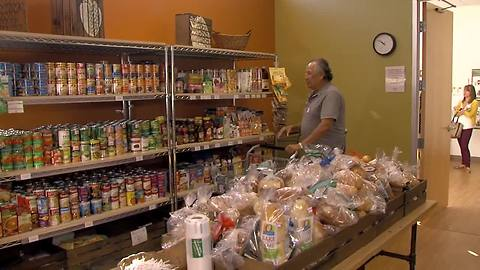 Food pantry designed to look like grocery store