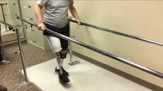 Drunk driving crash victim takes his first steps - Video
