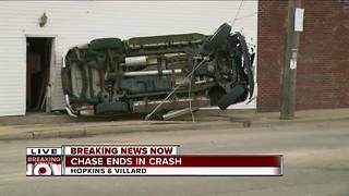 Car chased by police hits building