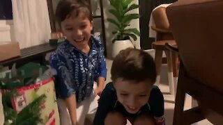 Kids surprised with new puppy for Christmas