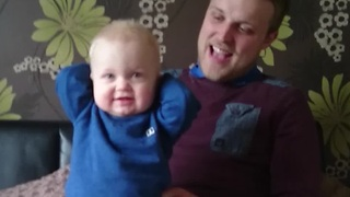 Baby's priceless reaction to dad's soccer chant - Video