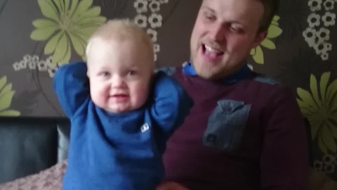 Baby Has Priceless Reaction To Dad's Soccer Chant