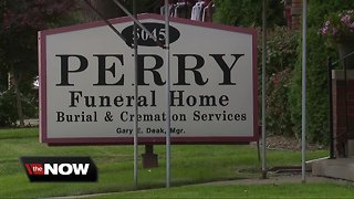 Couple files lawsuit against Perry Funeral Home