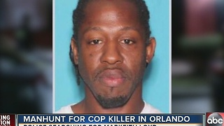 Orlando police officer shot and killed, suspect on the run