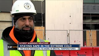 Construction workers, garbage collectors head to work in the cold