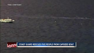 Coast Guard rescues 5 people from capsized boat - Video